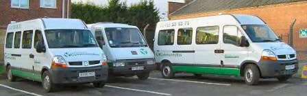 Photograph: Three Lutterworth Community Buses lined up in the car park at the Volunteer Centre.